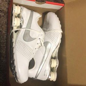 White and silver Nike shocks